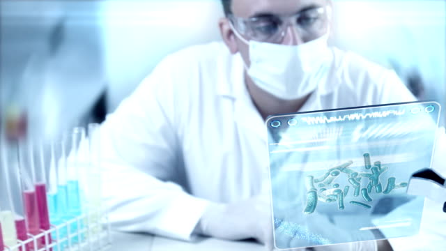 chemist at work in a laboratory. - medical procedure stock videos and b-roll footage