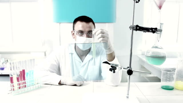 chemist at work in a laboratory. - repetition stock videos & royalty-free footage