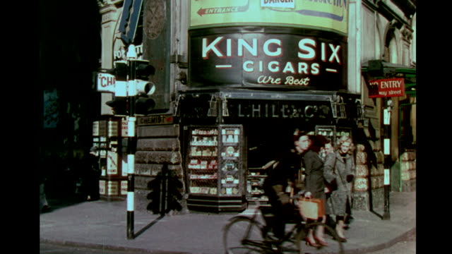 chemist cigar store in piccadilly circus heavy pedestrian traffic walking by chemist cigar store in piccadilly circus on january 01 1944 in london - the blitz stock videos and b-roll footage