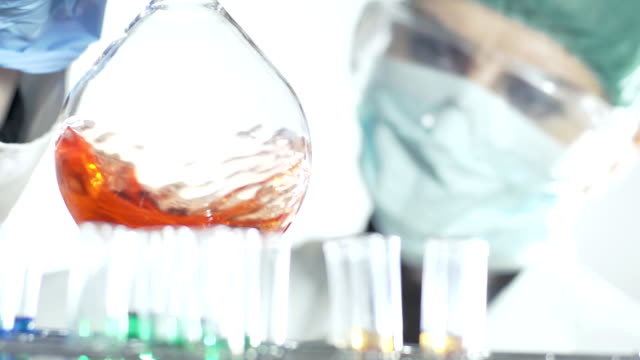 hd time-warp: chemist mixing a solution - mixing stock videos & royalty-free footage
