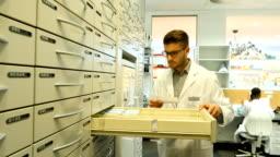 Chemist searching prescription medicine in pharmacy