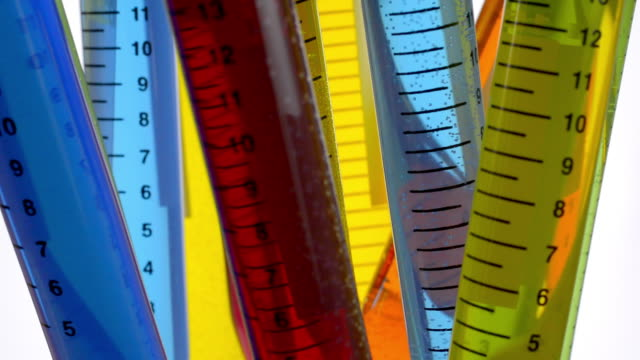 Chemistry. Rotating colorful test tubes