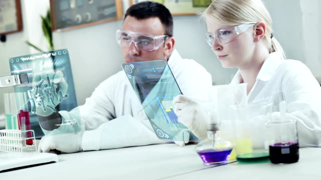 chemists at work in a laboratory. - replication bubble stock videos and b-roll footage
