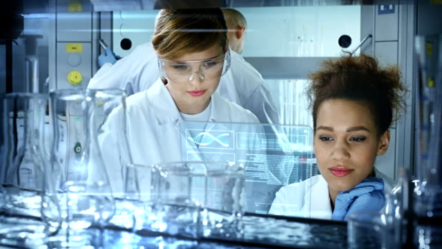 Chemists in modern Laboratory.