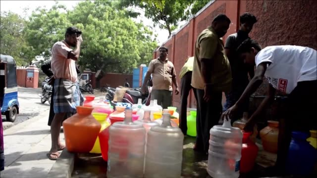 chennai indian residents wait with plastic pots fill drinking water at a distribution point in chennai on june 19 2019 - drinking stock videos & royalty-free footage