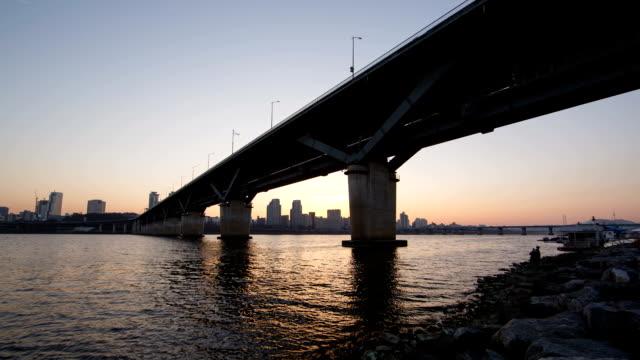 cheongdamdaegyo bridge at sunset to night - sunset to night stock videos & royalty-free footage