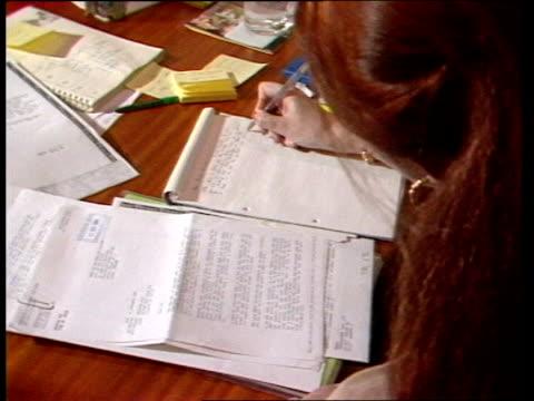 stockvideo's en b-roll-footage met cheque presented to bob geldof itn london london garage bob geldof speaking on telephone in band aid trust office tms woman making notes behind desk... - bob geldof