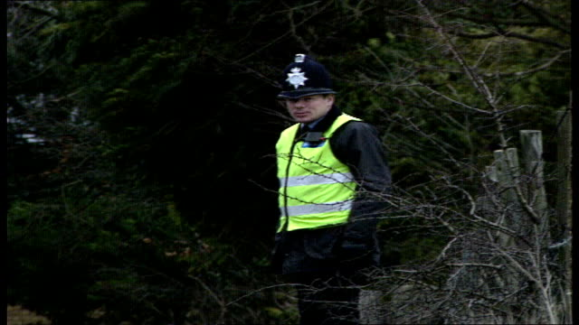chequers 02:30 gv of church with as police officers stand nearby, bucks gv of prime minister margaret thatcher out of car and walks up hill holding... - hackney stock videos & royalty-free footage