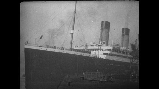 cherbourg a tender comes up to the ship and passengers disembark onto the tender / southampton pan of ship passengers disembark / tugboat pulls ship... - normandie stock-videos und b-roll-filmmaterial