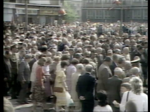 vídeos de stock, filmes e b-roll de chernobyl nuclear leak set aside for may day celebrations poland ext tms two children holding small flags ms crowd marching lr carrying banners and... - 1986