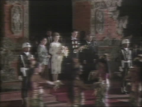 russian nuclear leak; k) indonesia: bali: airport: ext tms ronald reagan as nancy reagan stands behind him and woman puts garland round his neck tgv... - leaking stock videos & royalty-free footage