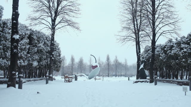 ws cherry in spoon sculpture during winter with snow on it / minneapolis, minnesota, united states - spoon stock videos & royalty-free footage