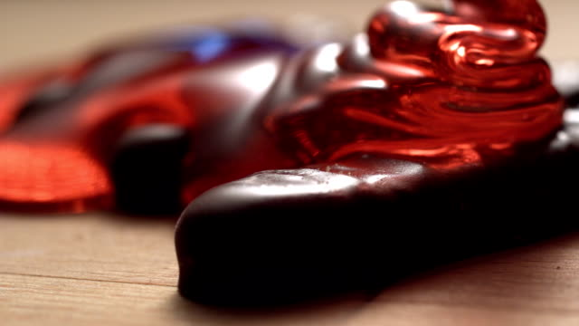 cherry jelly covering chocolate bars - gelatin stock videos and b-roll footage