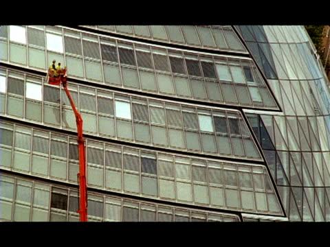 MS Cherry picker rising, City Hall building, London, England