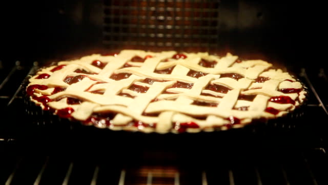 cherry pie cooking in oven - baked stock videos & royalty-free footage
