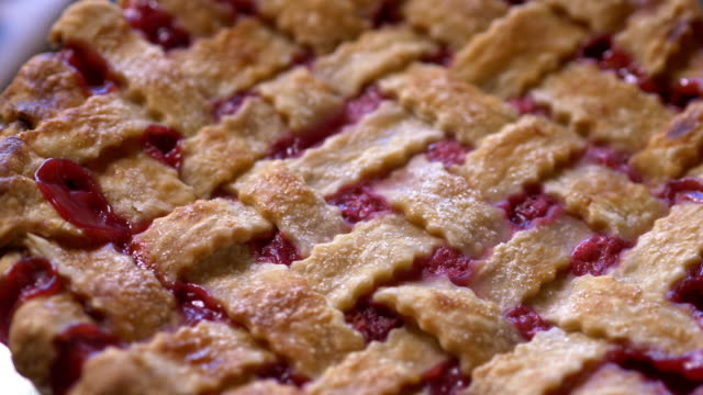 cherry pie with lattice crust close up, from above - dessert stock videos & royalty-free footage