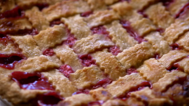 Cherry pie with lattice crust close up, from above