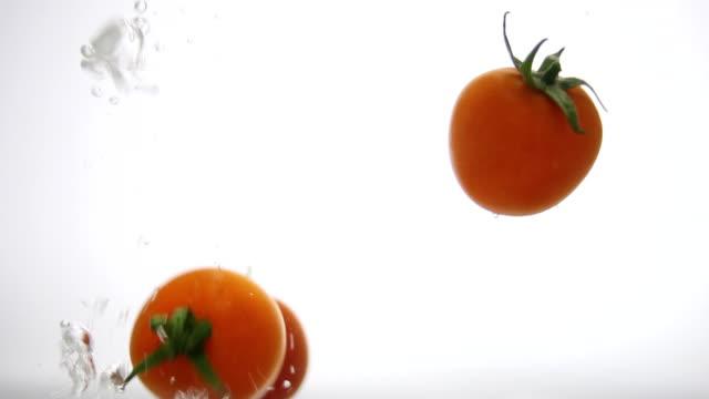 Cherry Tomatoes Splashing into the Water