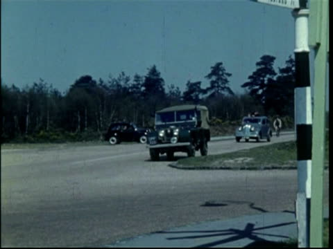 chertsey sign posts; car full of family drives on road and then off road for a picnic, april 1951 - surrey england stock videos & royalty-free footage