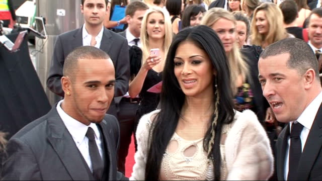 cheryl cole 'dropped' from american xfactor show 1152011 / r11051103 lewis hamilton and girlfriend nicole scherzinger along red carpet at event - lewis hamilton nicole scherzinger stock videos and b-roll footage