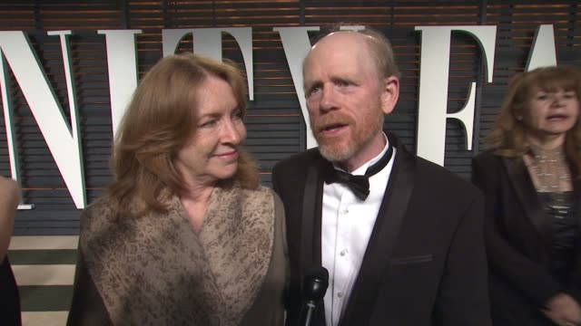 interview cheryl howard and ron howard at the 2015 vanity fair oscar party hosted by graydon carter at the wallis annenberg center for the performing... - wallis annenberg center for the performing arts stock videos and b-roll footage