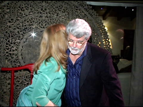 Cheryl Howard Crew and George Lucas at the In the Face of Jinn Release Party at Private Residence in Pacific Palisades California on April 18 2005