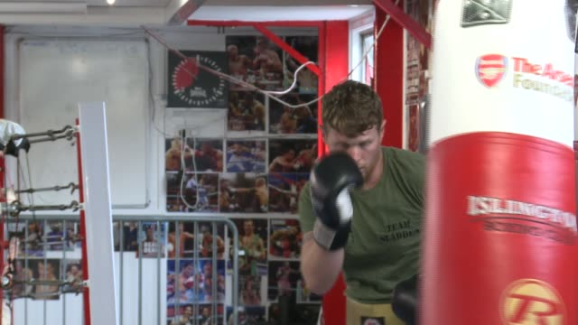 chess boxing gym general views; england: london: islington: int various of man punching punch bag - islington stock videos & royalty-free footage
