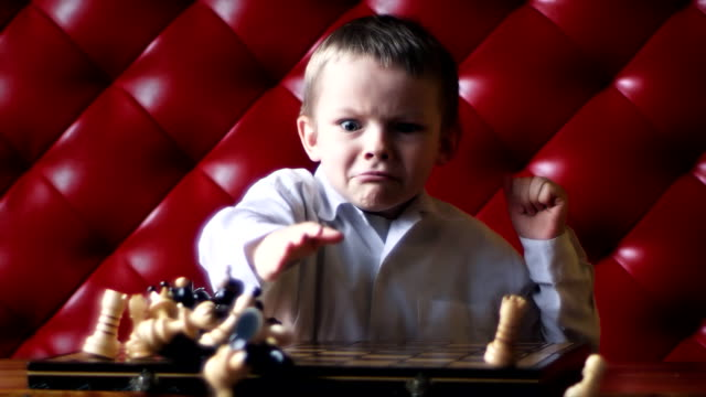 stockvideo's en b-roll-footage met chess boy anger - woede