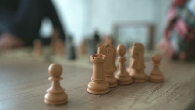 chess chess figures on table - chess stock videos & royalty-free footage