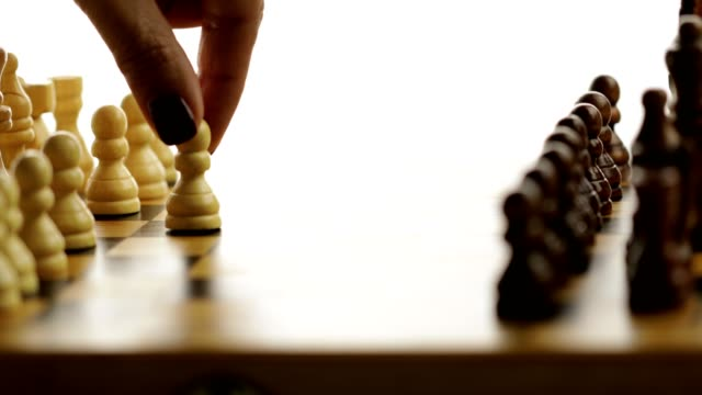 chess game starts by white pawn moving forward - beginnings stock videos & royalty-free footage