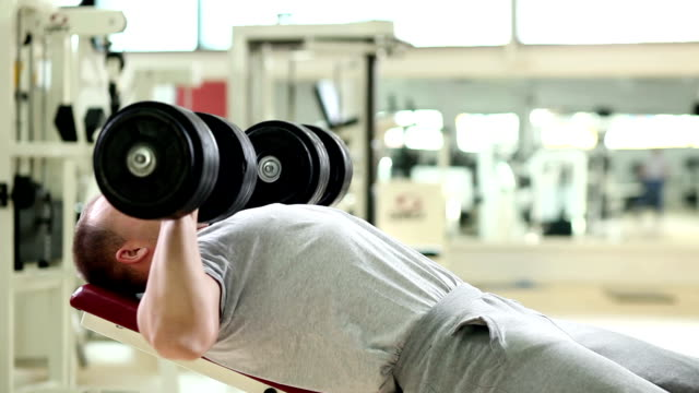 chest press - dumbbell stock videos & royalty-free footage