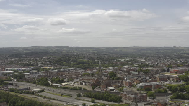 chesterfield derbyshire town centre and church rising reveal wide aerial view - spire stock videos & royalty-free footage
