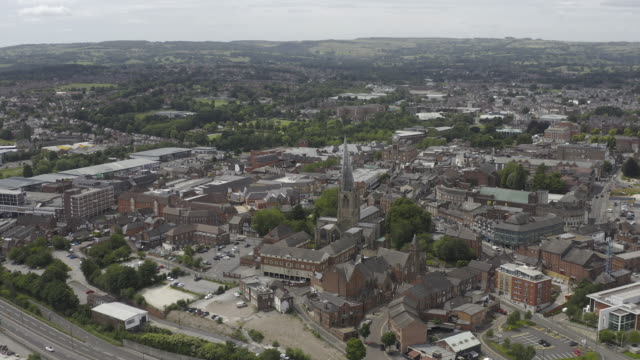 chesterfield derbyshire town centre and crooked spire church tracking aerial view - derbyshire stock videos & royalty-free footage