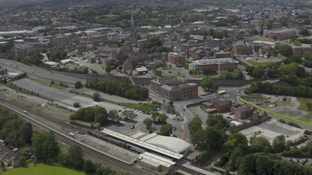 chesterfield derbyshire town centre train arriving railway station aerial view - spire stock videos & royalty-free footage