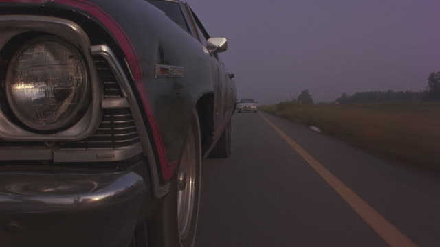a chevelle malibu speeding down a country road. - overtaking stock videos and b-roll footage