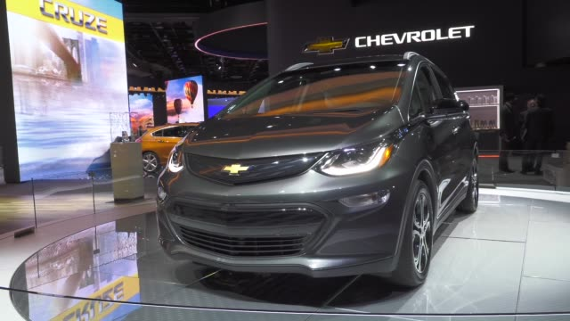 chevrolet all electric bolt ev on a rotating turntable at the detroit auto show the new entry into the allelectric market by general motors has a... - chevrolet stock videos & royalty-free footage