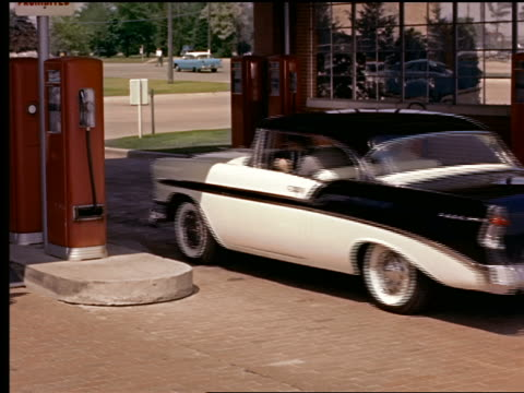 1955 chevrolet bel air pulling into gas station + attendant preparing to fill up gas tank - gas station attendant stock videos and b-roll footage