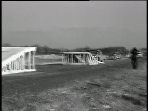 b/w 1962 pan chevrolet biscayne sedan doing jump between two ramps in test - chevrolet stock videos & royalty-free footage