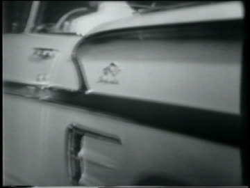 b/w 1958 side view chevrolet impala convertible driving away from camera at night - 1958 stock videos & royalty-free footage