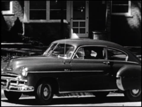vídeos de stock, filmes e b-roll de chevrolet promotes the first automatic transmission in a lowpriced car tons of great shots of the 1950 and 1951 chevrolets driving in all kinds of... - automático