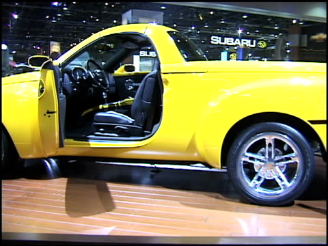 mws chevrolet ssr pickup truck revolving on turntable / ms interior and rear end of truck / xcu front end / ws narrator operates retractable roof and... - chevrolet truck stock videos & royalty-free footage