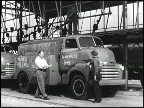 chevrolet trucks owned by the clark oil co are filled with fuel oil and make both urban and suburban deliveries montage 1950 chevy truck delivers... - chevrolet truck stock videos & royalty-free footage