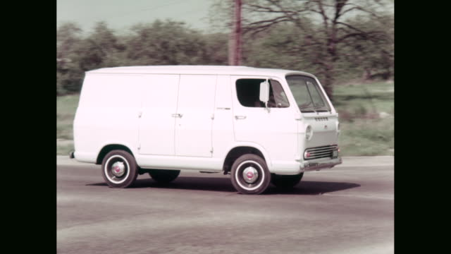 WS 1965 Chevrolet van moving on suburban street / United States
