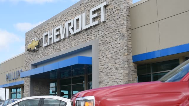 chevrolet vehicles sit on display outside at the phillips chevrolet dealership in frankfort illinois us on april 29th 2015 shots shots pan up from a... - chevrolet truck stock videos & royalty-free footage
