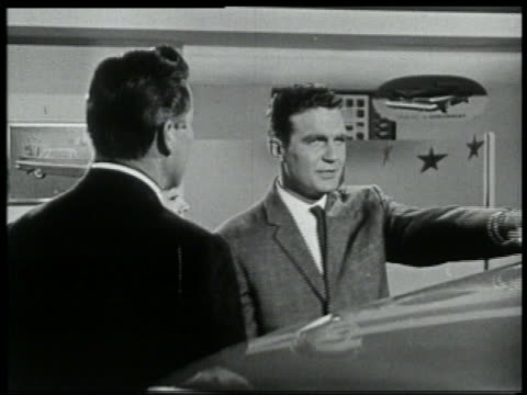 b/w 1959 chevy car salesman giving sales pitch to couple / is distracted by something off screen - salesman stock videos and b-roll footage