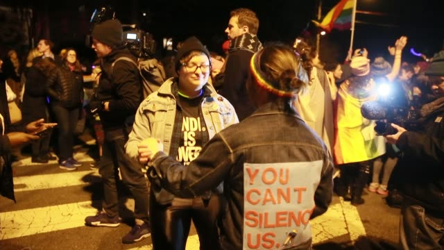 Members of the LGBTQ and ally community hold a queer dance party on Primrose Street near the new home of vice president elect Mike Pence in Chevy...