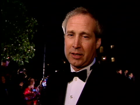 chevy chase talks to reporters about his upcoming projects, hosting ceremony, his talk show, family and john candy's death. - talk show stock videos & royalty-free footage