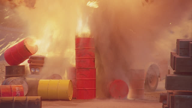 vidéos et rushes de chevy delivery truck parked near gas cans burns, then explodes - essence