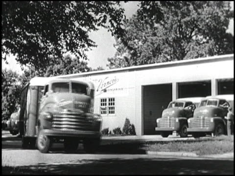 chevy truck drives from the factory through city streets and highways to deliver vernor's ginger ale to drug stores and supermarkets montage 1950... - chevrolet stock videos & royalty-free footage