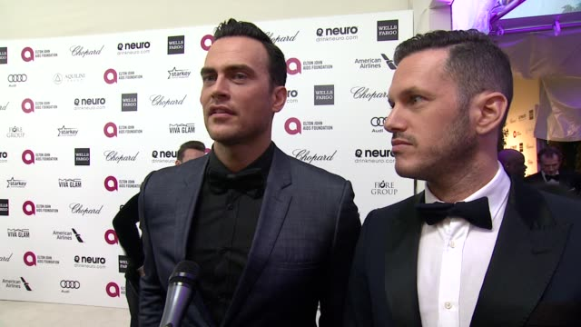 vídeos de stock, filmes e b-roll de interview cheyenne jackson on being at the event and on elton john at the 23rd annual elton john aids foundation academy awards viewing party... - festa do oscar